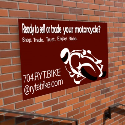 Aluminium on brick wall with motorcycle graphic
